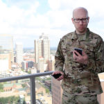 Man in military getting ready to video chat